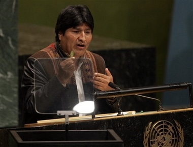 Bolivian president Evo Morales holds a coca leaf as he addresses the 61st session of the U.N. General Assembly at the United Nations headquarters, Tuesday, Sept. 19, 2006